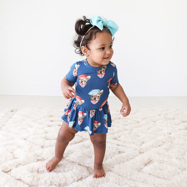 Baby wearing Blue Dog Print Frenchie Short Sleeve Twirl Skirt Bodysuit