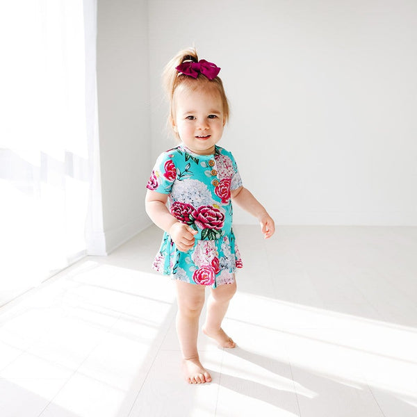 Baby on floral Eloise Short Sleeve Henley Twirl Skirt Bodysuit