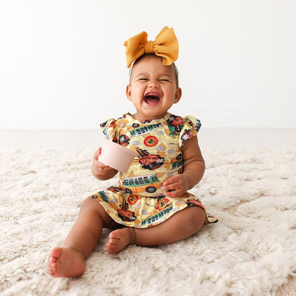Laughing baby on Rosa Parks Ruffled Cap Sleeve Twirl Skirt Bodysuit