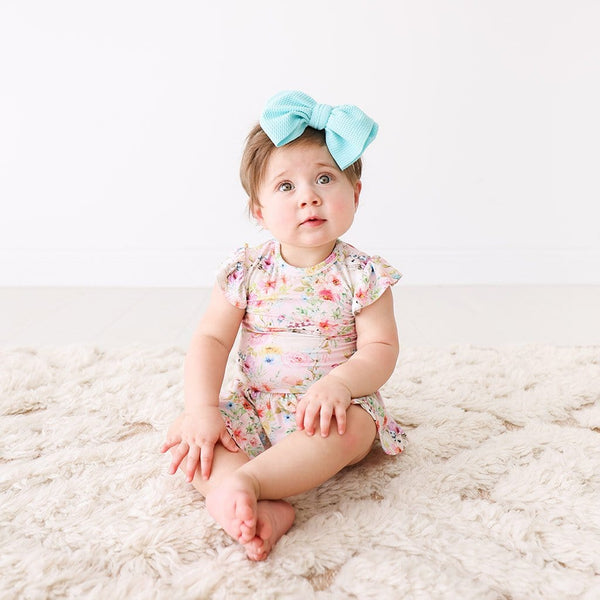Baby wearing Rose Ruffled Cap Sleeve Twirl Skirt Bodysuit
