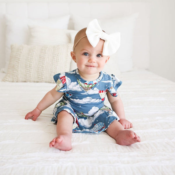 Baby girl wearing Tanner Ruffled Cap Sleeve Twirl Skirt Bodysuit