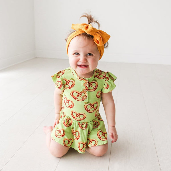 Baby on Pretzel Ruffled Cap Sleeve Henley Twirl Skirt Bodysuit