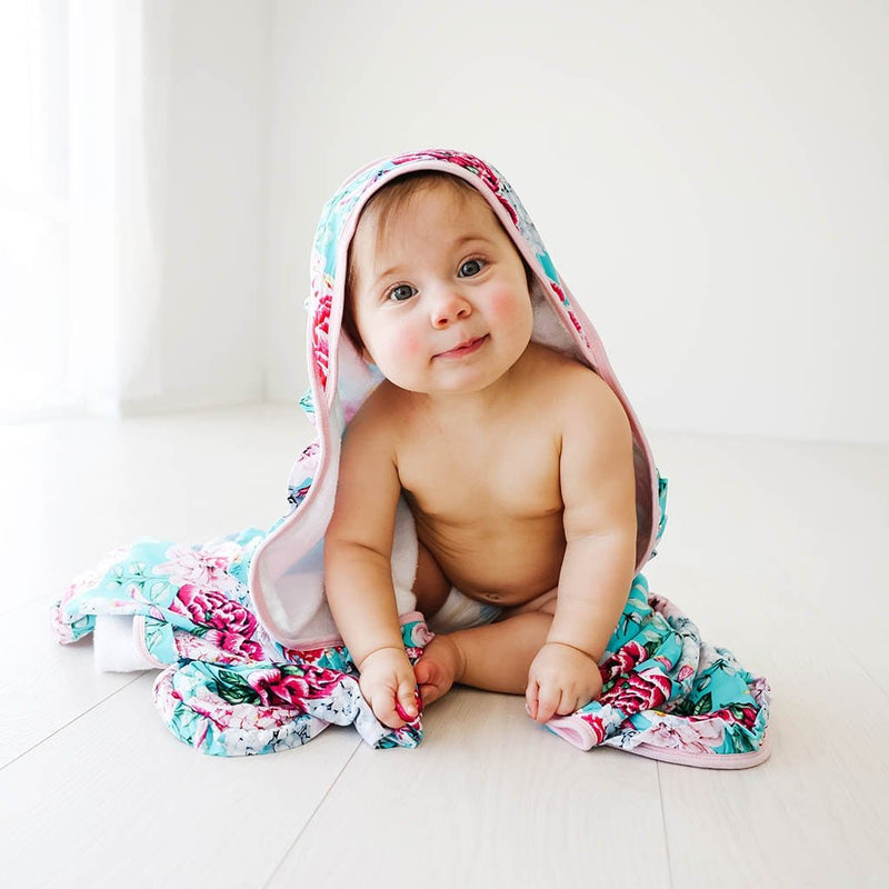 Sitting baby on floral Eloise Ruffled Hooded Towel