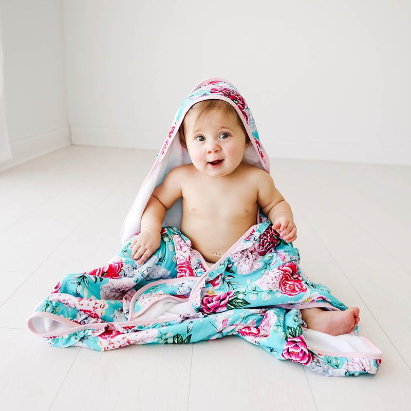 Baby playing with Eloise Ruffled Hooded Towel