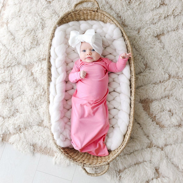 Baby on crib wearing Pink Lemonade Zippered Gown