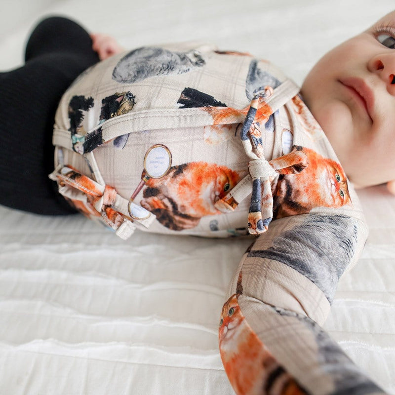 Baby lying on bed wearing Collyns Tie-Front Kimono Set