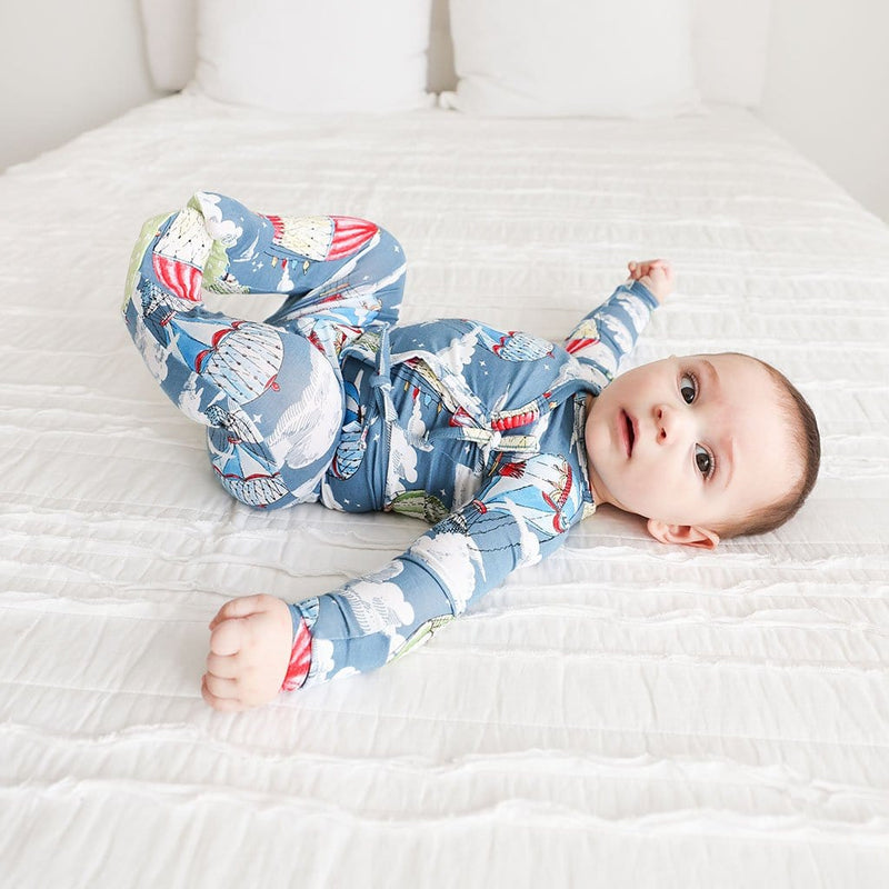 Baby in bed wearing Tanner Tie-Front Kimono Set
