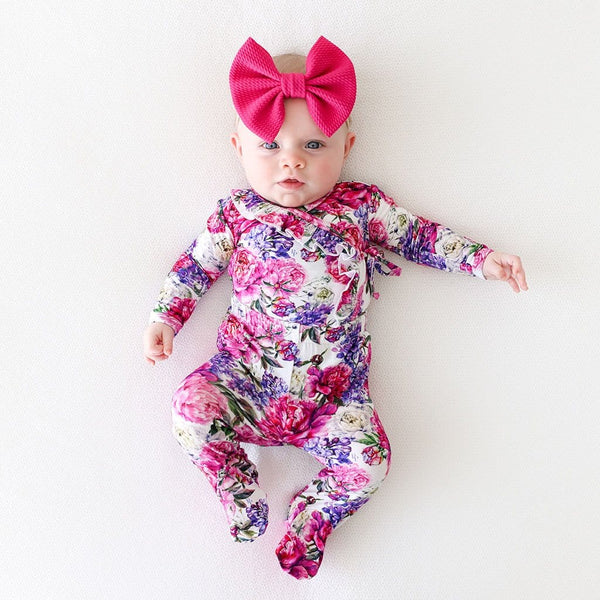 Baby with pink ribbon wearing Bella Ruffled Tie-Front Kimono Set