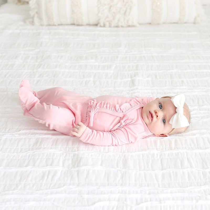 Baby on bed wearing Cotton Candy Ruffled Tie-Front Kimono Set