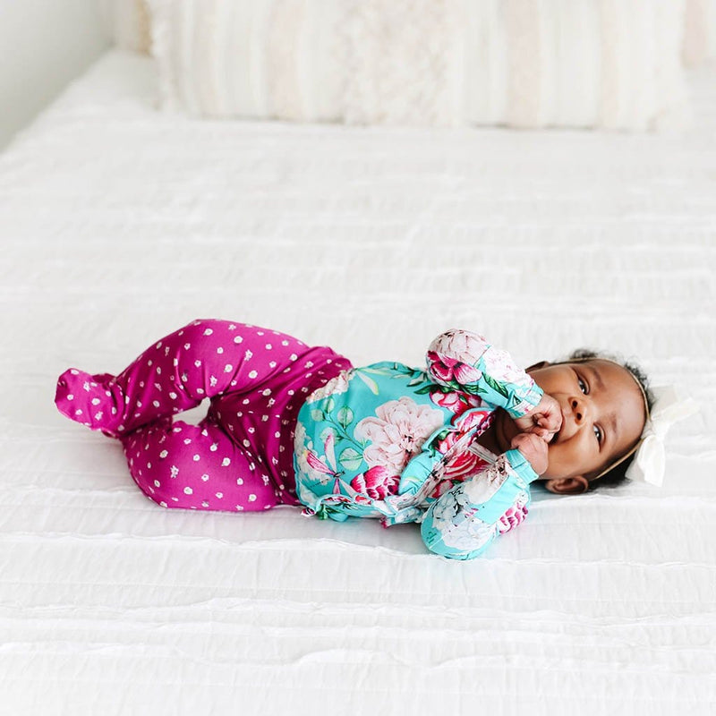 Baby in bed wearing Eloise Ruffled Tie-Front Kimono Set