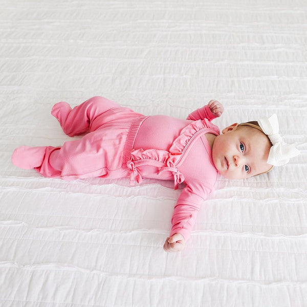 Baby on bed wearing Pink Lemonade Ruffled Tie-Front Kimono Set