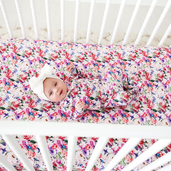 Baby lying on Vivienne Crib Sheet