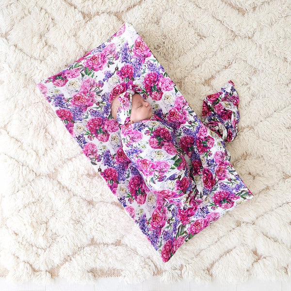 Baby lying on Floral Bella Pad Cover