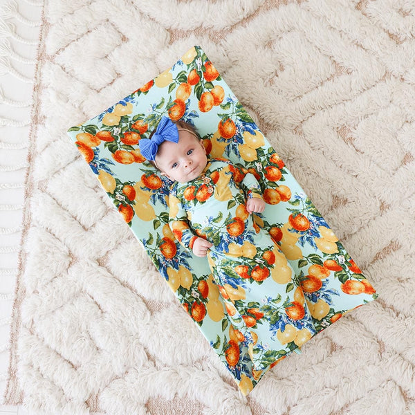 Baby lying on Lucia Pad Cover