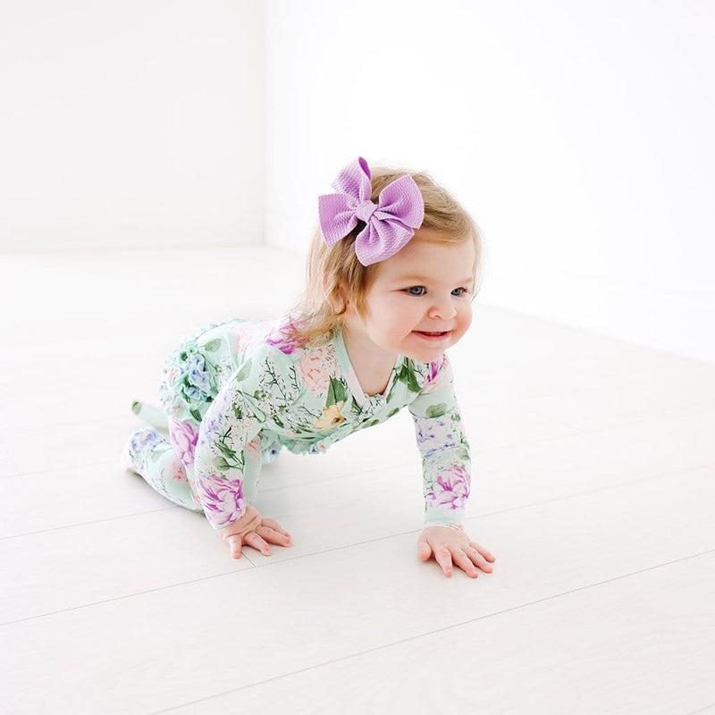 Crawling baby wearing Floral Erin Footie Ruffled Zippered One Piece