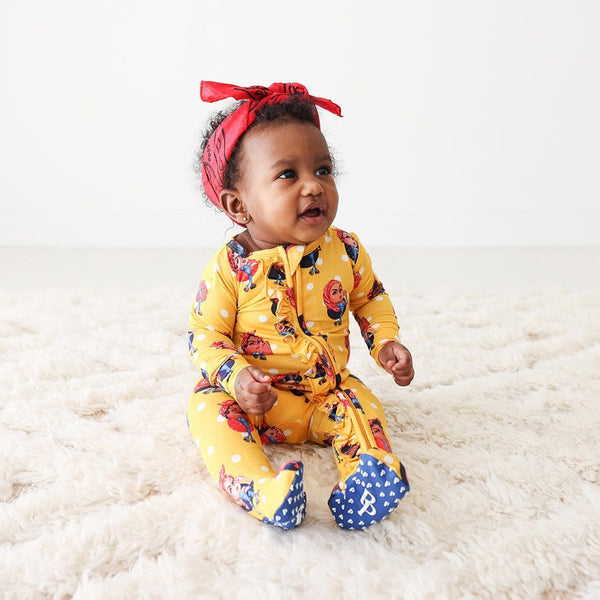 Baby wearing Rosie the Riveters Footie Ruffled Zippered One Piece