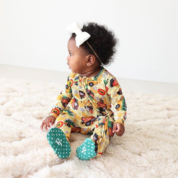 Baby on Rosa Parks Footie Ruffled Zippered One Piece