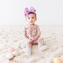 Baby wearing Rose Footie Ruffled Zippered One Piece