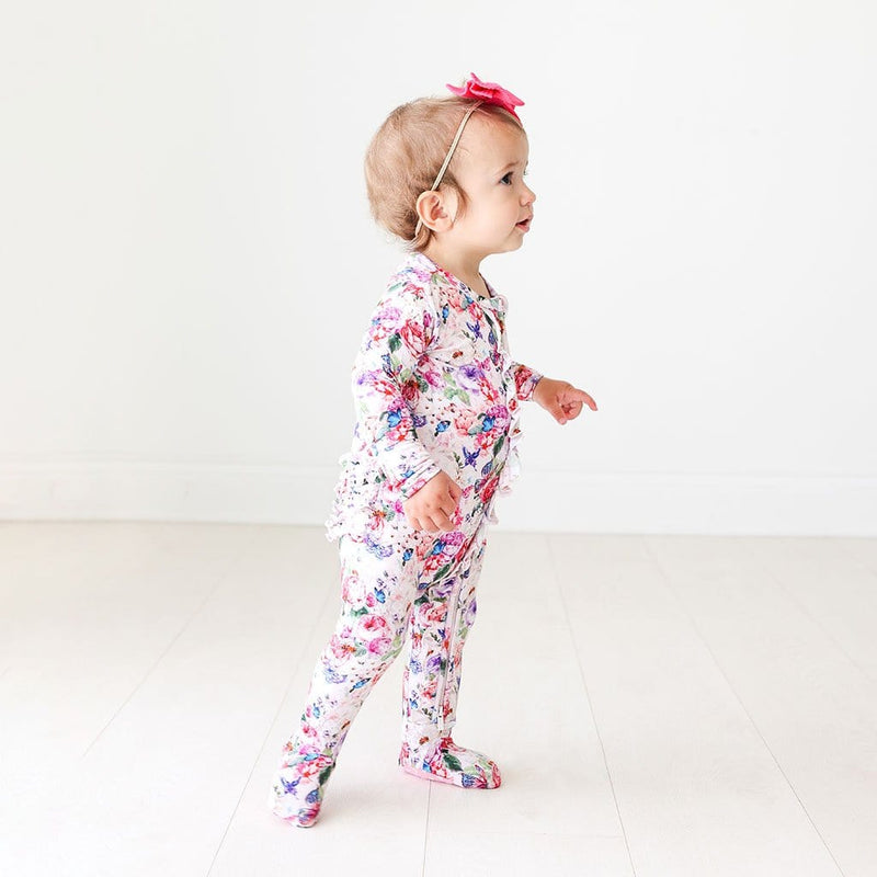 Baby wearing Vivienne Footie Ruffled Zippered One Piece
