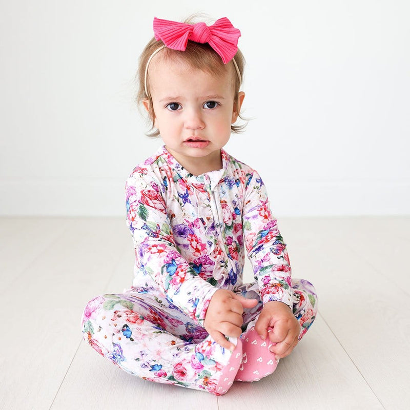 Baby sitting wearing Vivienne Footie Ruffled Zippered One Piece