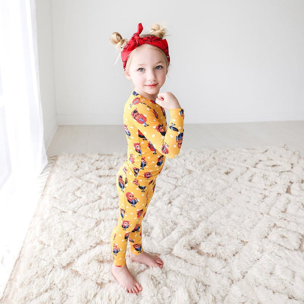 Toddler wearing Rosie the Riveters Long Sleeve Pajamas