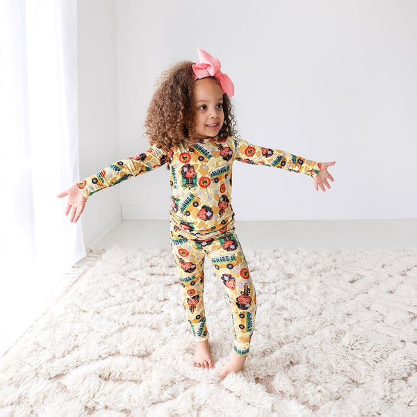 Toddler with ribbon wearing Rosa Parks Long Sleeve Pajamas