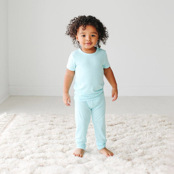 Toddler wearing Robins Egg Short Sleeve Pajamas