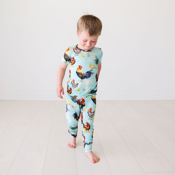 Kid wearing Rhett Short Sleeve Pajamas in chicken print
