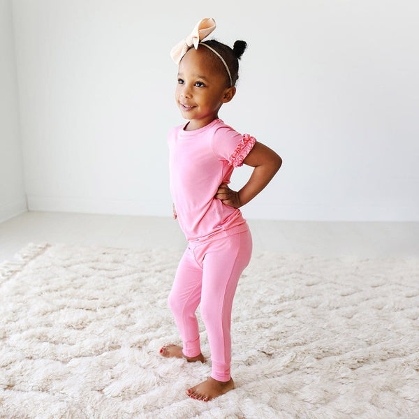 Toddler wearing Pink Lemonade Ruffled Short Sleeve Pajamas
