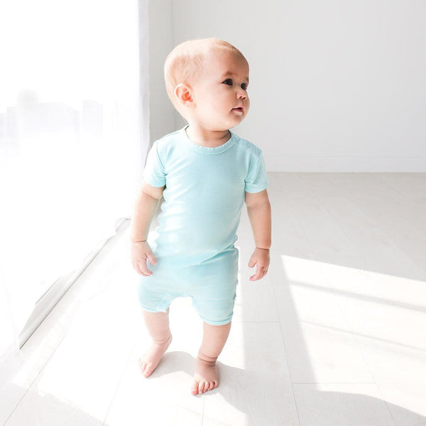 Walking baby wearing Robins Egg Short Sleeve Short Romper