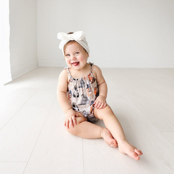 Baby wearing Collyns Sleeveless Bubble Romper