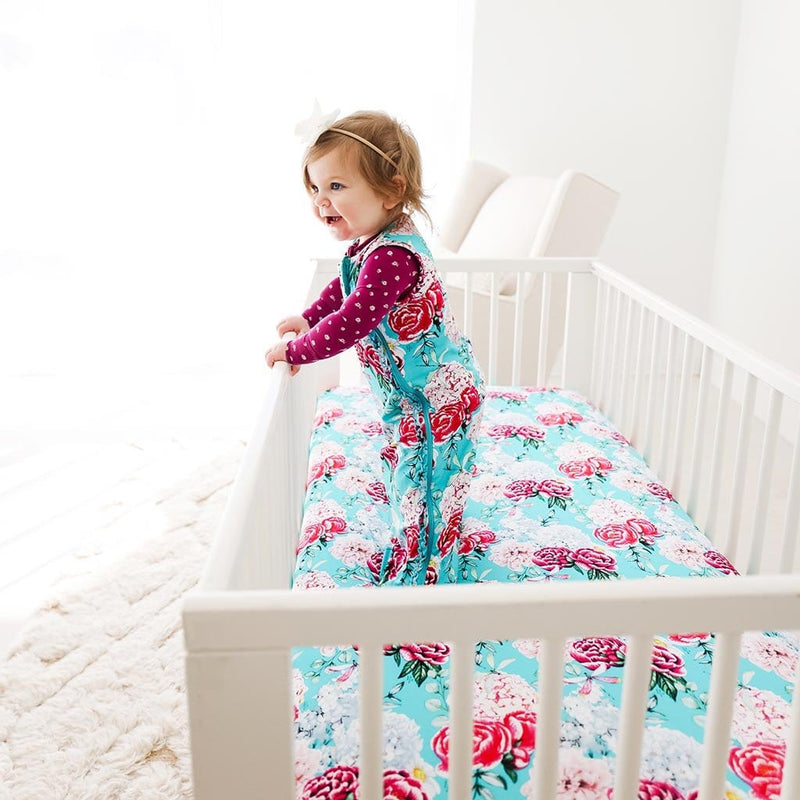 Baby wearing floral Eloise Sleeveless Ruffled Sleep Bag 0.5 Tog