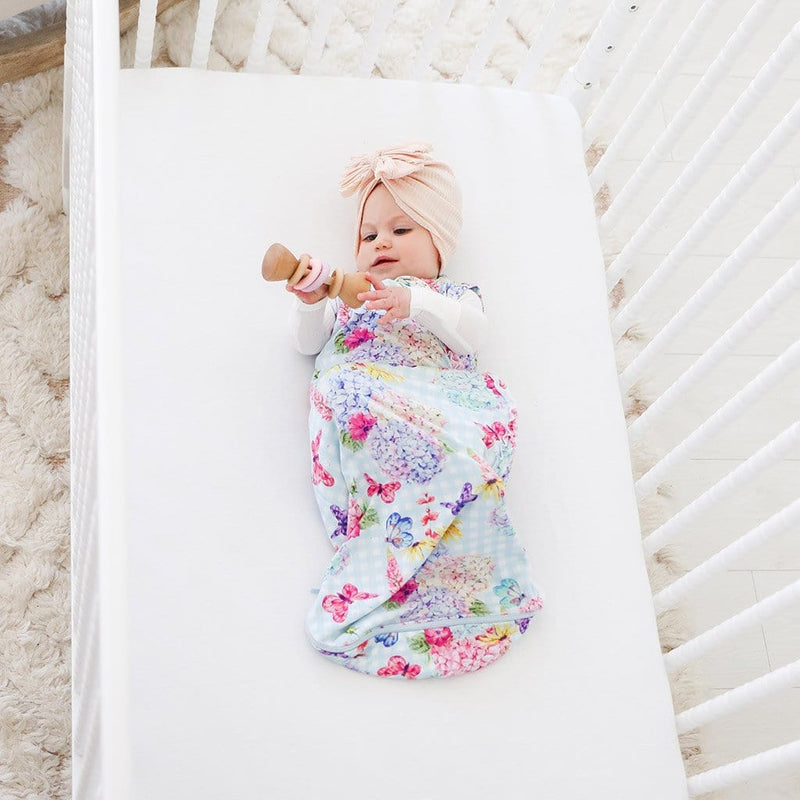 Baby on crib wearing Nicolette Sleeveless Ruffled Sleep Bag 2.5 Tog