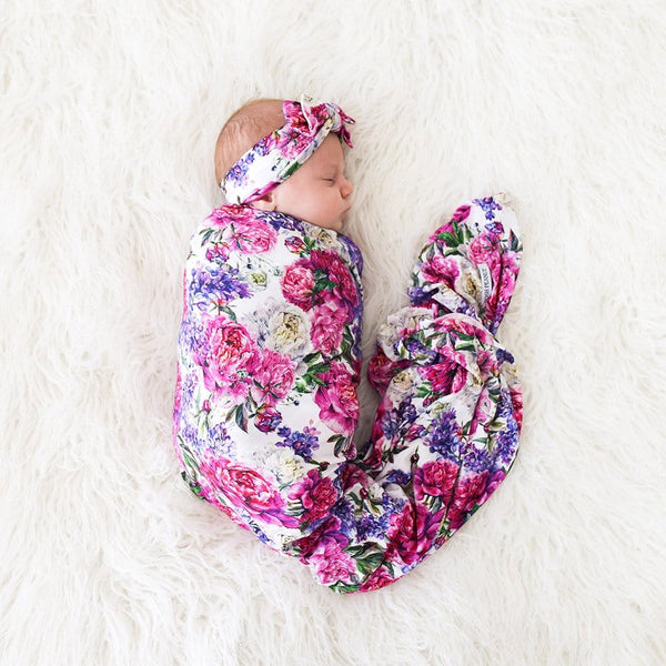Baby wrapped in Bella Swaddle Headband Set