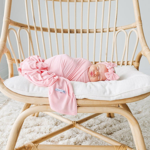 Baby sleeping wearing Cotton Candy Swaddle Headband Set