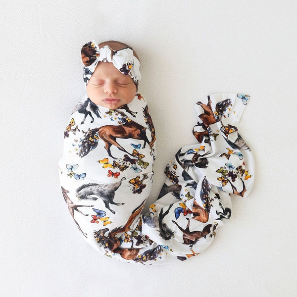 Baby on animal printed Claire Swaddle Headband Set