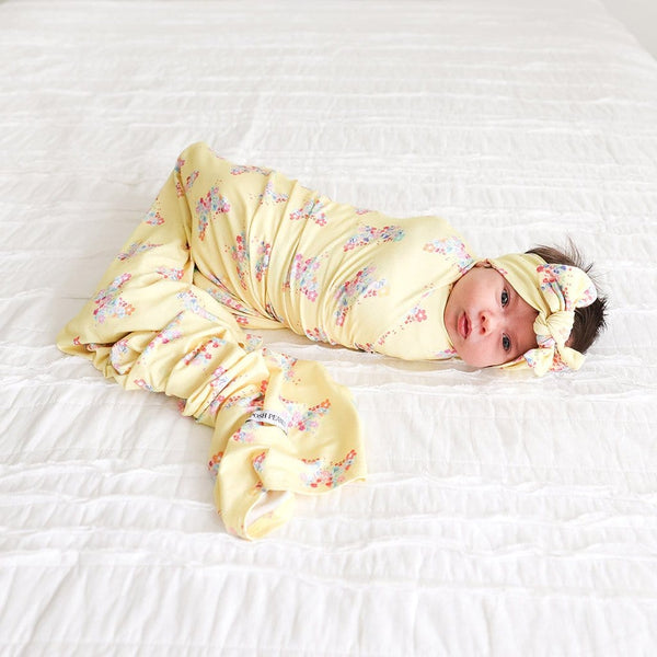 Baby wearing Keira Swaddle Headband Set