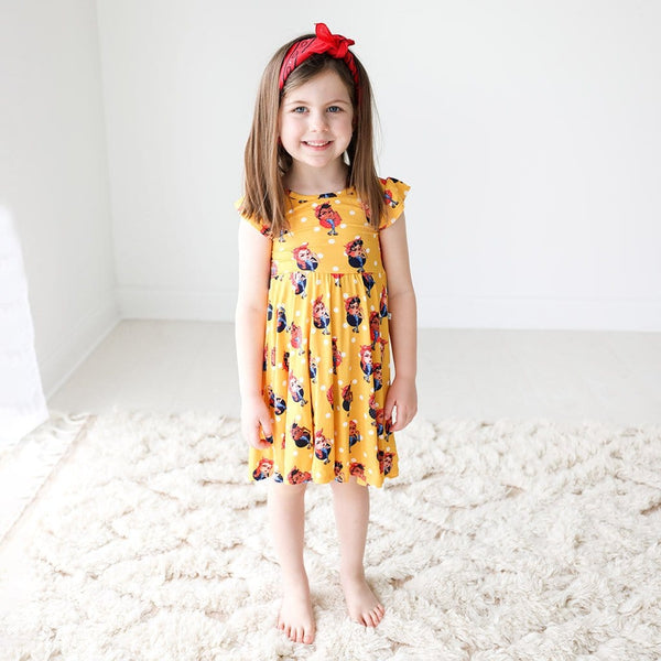 Toddler wearing Rosie the Riveters Ruffled Cap Sleeve Twirl Dress