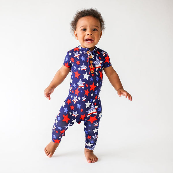 Standing toddler wearing Washington short sleeve henley romper