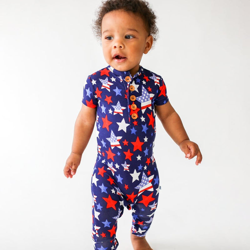 Walking baby wearing Washington short sleeve henley romper