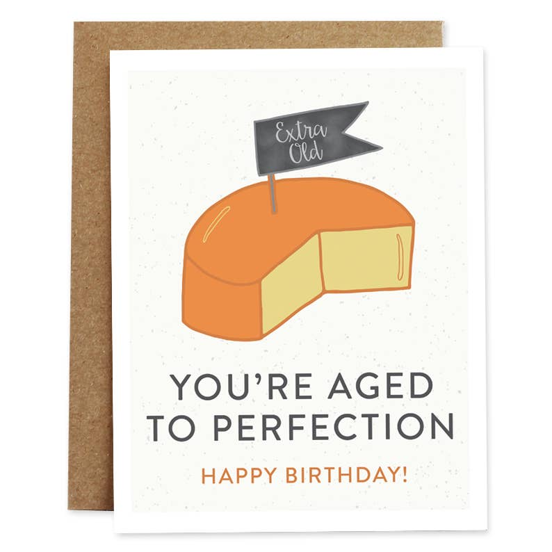 "4 inch by 5 inch birthday card. Block of cheese. ""You're aged to perfection."" Blank on the inside."