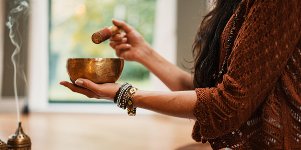 women meditating with sound bowl for healing and spirituality