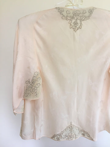 Peach 1940s jacquard woven silk bed jacket with drawn lace work and silk georgette and tulle embellishment appliqué.
