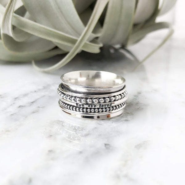 "Spinner Message Ring ""you are loved"" Sizes 8, 9 & 10"