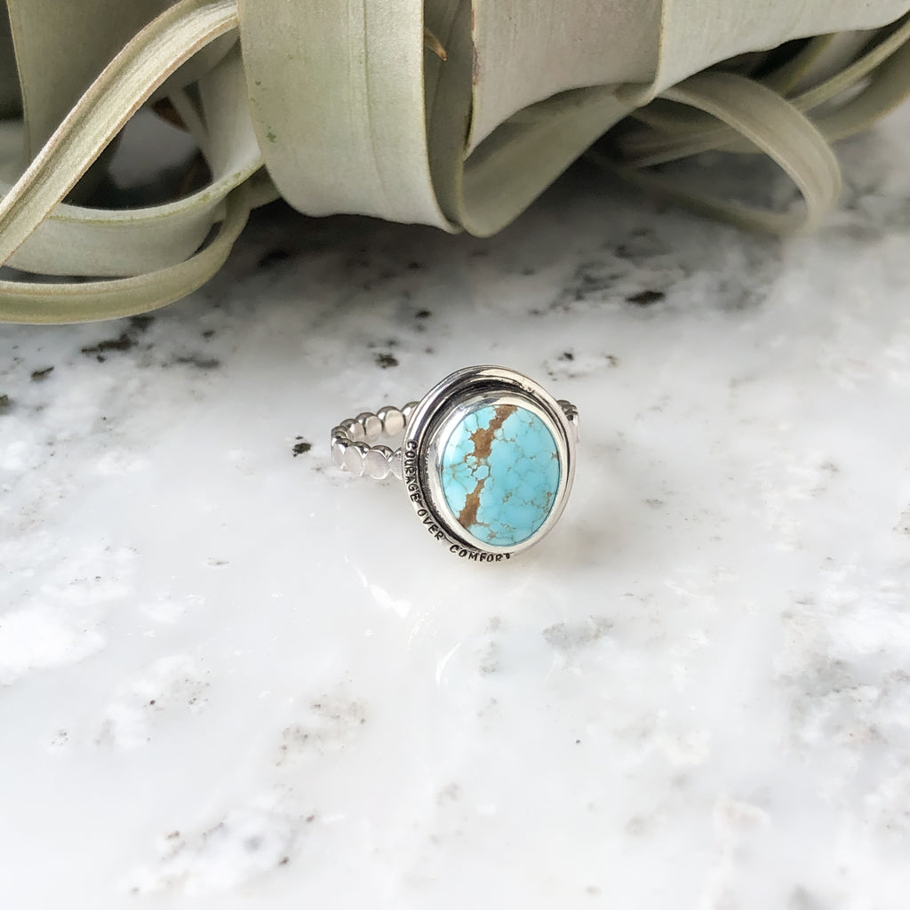 "Turquoise Ring in Sterling Silver Size 8 with ""courage over comfort"""