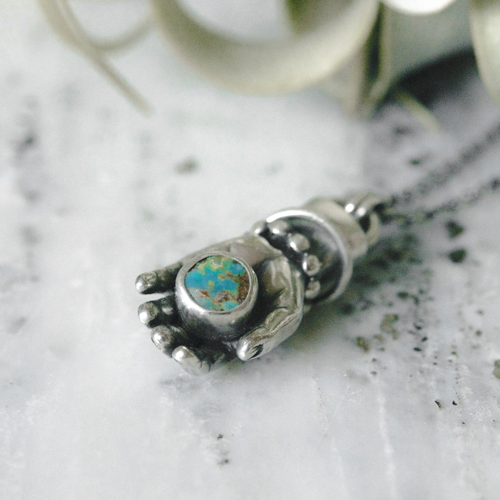 Hand Holding Turquoise with Diamond Ring & Bangles Necklace