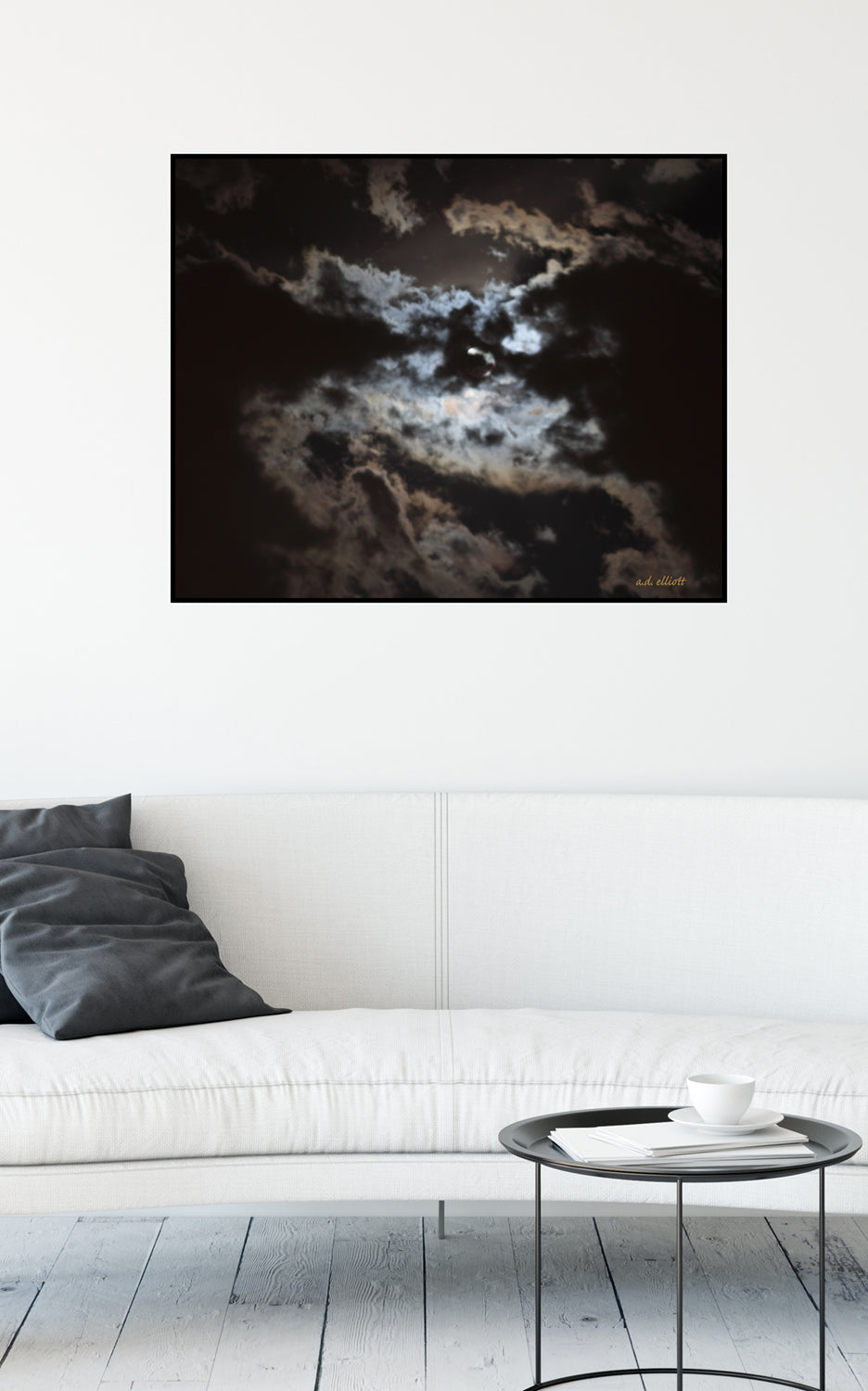 A photograph of the moon obscured behind clouds taken by the Arkansas photographer a.d. elliott.  Printed on high quality, artist-grade stock and folded around a lightweight frame to give them a gorgeous, gallery-ready appearance. With acid-free ink that will last without fading or chipping, Features a scratch-resistant UV coating. Wipes clean easily with a damp cloth or to remove dust, vacuum gently using a soft brush attachment.