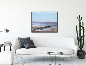 A landscape photograph of pier remains on the Great Salt Lake near Rozel Point. Taken by the Arkansas photographer a.d. elliott.  Printed on high quality, artist-grade stock and folded around a lightweight frame to give them a gorgeous, gallery-ready appearance. With acid-free ink that will last without fading or chipping, Features a scratch-resistant UV coating. Wipes clean easily with a damp cloth or to remove dust, vacuum gently using a soft brush attachment.
