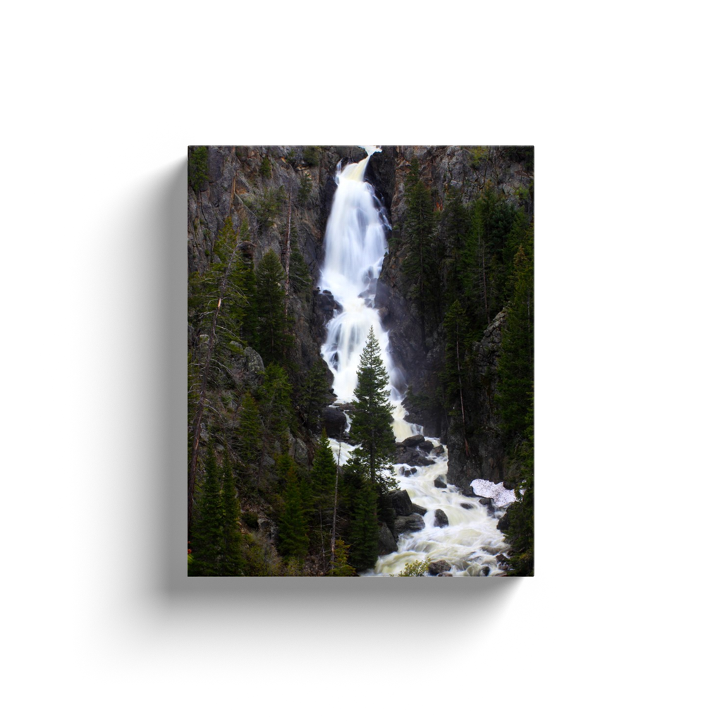 A long-exposure photograph of Fish Creek Falls, Steamboat Springs Colorado, taken by the photographer a.d. elliott.  Printed on high quality, artist-grade stock and folded around a lightweight frame to give them a gorgeous, gallery-ready appearance. With acid-free ink that will last without fading or chipping, Features a scratch-resistant UV coating. Wipes clean easily with a damp cloth or to remove dust, vacuum gently using a soft brush attachment.