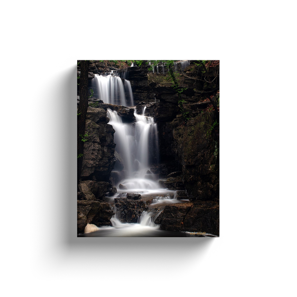 A long exposure photograph of Norwood Falls taken by the photographer a.d. elliott.  Printed on high quality, artist grade stock and folded around a lightweight frame to give them a gorgeous, gallery ready appearance. With acid free ink that will last without fading or chipping, Features a scratch-resistant UV coating. Wipes clean easily with a damp cloth or to remove dust, vacuum gently using a soft brush attachment.